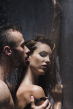 Naked man kissing woman Stock Image