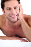 Naked man lying on massage table Royalty Free Stock Photos