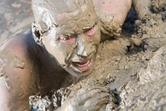 Naked man  mud Royalty Free Stock Image
