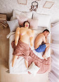 Naked man in pants sleep with rubber doll. Stock Photography