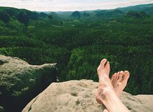 Naked man& x27;s legs relaxing in mountains with nice view. Naked man& x27;s legs relaxing in mountain landscape with view into natural park, trip, trekking royalty free stock image
