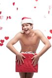 Naked man in santa hat holding christmas gift Stock Photo