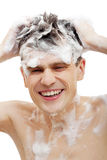 Naked man with shampoo over hair Stock Photo