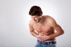 Naked man with stomachache Royalty Free Stock Photos
