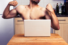 Naked man trying to impress during webcam chat Royalty Free Stock Photos