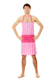 Naked man wering pink apron Stock Images