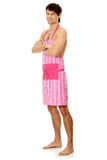 Naked man wering pink apron Royalty Free Stock Image