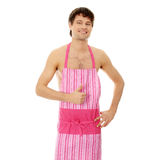 Naked man wering pink apron Stock Photo