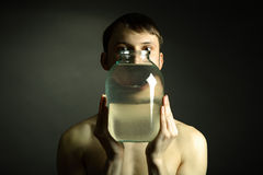 Naked Man With Vase Royalty Free Stock Photos