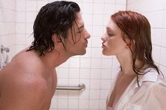 Naked Man and woman in love are kissing in shower Royalty Free Stock Image