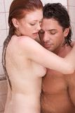 Naked Man and woman in love are kissing in shower Stock Image