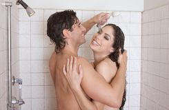 Naked Man and woman in love are kissing in shower Stock Photo