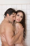 Naked Man and woman in love are kissing in shower Royalty Free Stock Photography