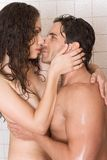 Naked Man and woman in love are kissing in shower Royalty Free Stock Images