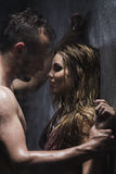 Naked man and woman in the shower Stock Images