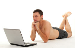 Naked man working on laptop Royalty Free Stock Image