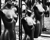 Naked mannequins in shop window. Black and White image of naked mannequins in shop windo Stock Photo