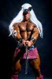 Naked muscular man warrior with a sword. Stock Image