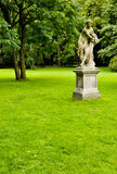 Naked nymph statue in the ornamental park Royalty Free Stock Images