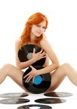 Naked redhead with vinyl recor Royalty Free Stock Photos