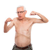 Naked senior man gesturing. Shirtless senior man gesturing and showing body, isolated on white background Royalty Free Stock Images