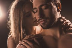 Naked sensual lovers hugging. With closed eyes stock photography