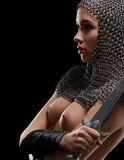 Naked sexy woman wearing chain mail holding a sword Royalty Free Stock Photos