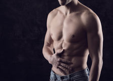 Stomach-ache. Naked torso of man. Man holding stomach in pain Royalty Free Stock Photos