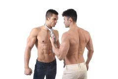 Naked torso young gay couple holding playing sexy together with necktie showing muscular strong bodies in homosexual men love Royalty Free Stock Images