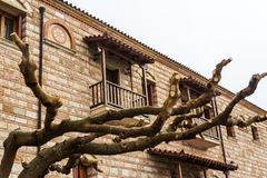 Naked tree in front of Christian orthodox monastery of the Virgin Mary in Malevi, Peloponnese, Greece.  stock image
