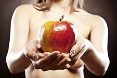 Naked woman with apple Stock Photography