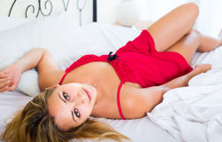 Naked woman on bed in bedroom Royalty Free Stock Image