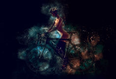 Naked woman with a bicycle Stock Image