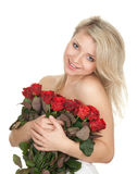 Naked woman with a bouquet of red roses Stock Image