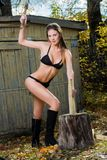 Naked woman chopping wood. lumberjack Stock Photography