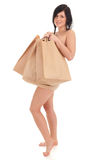 Naked woman covering by paper bags Stock Image
