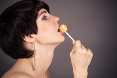 Naked woman licking lollipop. Beautiful naked woman licking lollipop Stock Photos