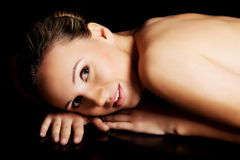 Naked woman lying on her belly. Stock Photography
