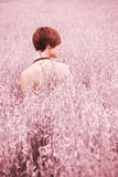 Naked woman on meadow Stock Image