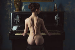 Naked woman and the piano Royalty Free Stock Image