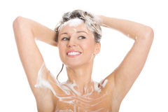 Naked woman shampooing her head. Royalty Free Stock Images