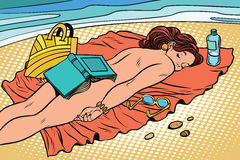 Naked woman sunbathing on the beach Royalty Free Stock Photography