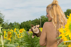 Naked woman surrounded by sunflowers.  Royalty Free Stock Photo