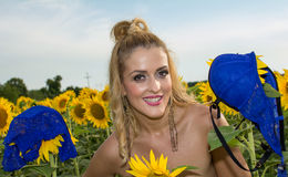 Naked woman surrounded by sunflowers.  Royalty Free Stock Photos