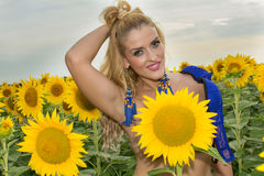 Naked woman surrounded by sunflowers.  Royalty Free Stock Images