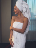 Naked woman with towel on her head and body after bath. Royalty Free Stock Image