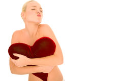 Naked Woman With Heart-shaped Pillow Stock Photo