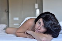 Free Naked Woman With Legs Dangling In The Bed Stock Photos - 156559063