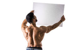 Naked young male bodybuilder holding blank board Stock Images