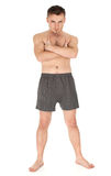 Naked young man with crossed arms Stock Image